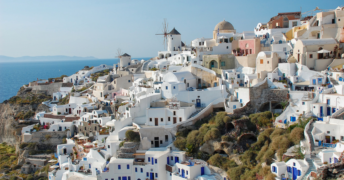 Daytime view of cliff dwellings in Oia
