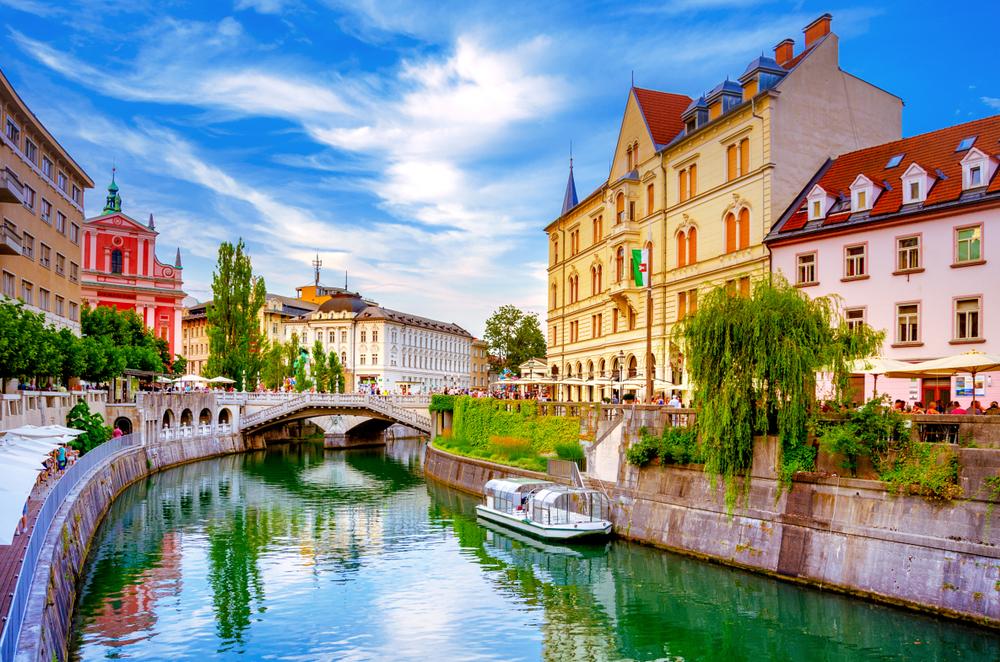 Cafes line the river in Ljublijana, Slovenia